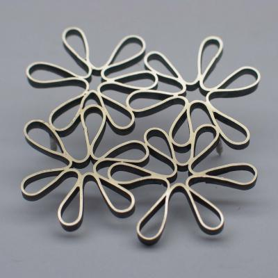 brooch by Yolanda Döpp  :  brooches modern silver loops